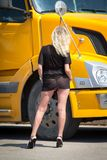 Girl in transparent dress. The girl in transparent dress in truck cab Royalty Free Stock Image