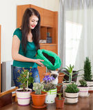 Girl transplanting potted flowers Royalty Free Stock Images