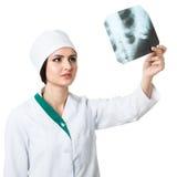 Girl traumatologist considers radiograph Stock Image