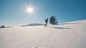 Girl travel hiking in winter mountains, trekking in wintertime, slow motion. Hd stock video