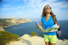 Girl with a travel map for mountain coast Royalty Free Stock Photo