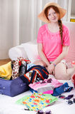 Girl during travel preparation Stock Images