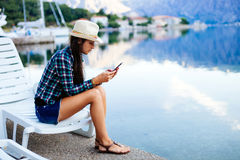 Girl travel and search in smartphone Royalty Free Stock Photography