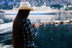 Girl travel and search in smartphone cruise liner background Stock Photo