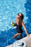Girl at travel spa resort pool. Stock Images