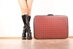 The girl traveler. Beautiful legs, girl, black boots suitcase Royalty Free Stock Image
