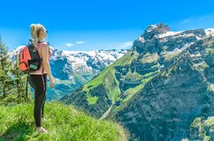 Girl traveler against the backdrop of the mountain peaks, the En. Gelberg resort, Switzerland Stock Images