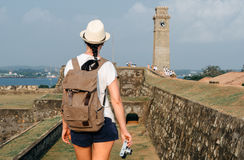 Girl traveler with a backpack and camera. Royalty Free Stock Photo