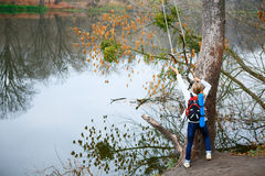 Girl traveler with bungee in the hands near autumn river Stock Photos