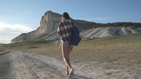 Girl traveler goes to the white cliff stock video