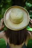 Girl traveler in the hat. Girl traveler in a straw hat Royalty Free Stock Images