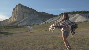 Girl traveler runing to the white cliff stock footage