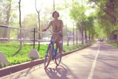 Girl traveling on bike Royalty Free Stock Photo