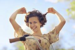 Girl traveling on bike. Happy girl traveling on bike Royalty Free Stock Photography