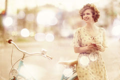 Girl traveling on bike Royalty Free Stock Photo