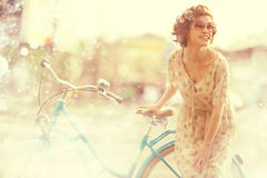 Girl traveling on bike Stock Photo
