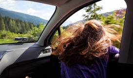 Girl traveling in a car Stock Photography