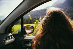 Girl traveling in a car Royalty Free Stock Photo