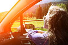 Girl traveling in a car Royalty Free Stock Image