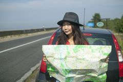 Traveling by car with a map on the road. Girl is traveling by car with a map on the road stock photography