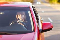 Girl traveling by car smiling Royalty Free Stock Photo
