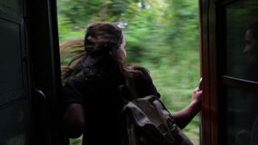 The girl is traveling by train.  stock footage
