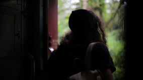 The girl is traveling by train at Sri Lanka.  stock footage