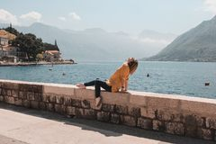 Girl travelling sea and mountains view in Montenegro. Perast royalty free stock photos