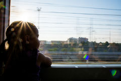 Girl travelling by train Royalty Free Stock Image