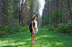 Girl travels the Altai taiga Royalty Free Stock Photo