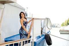 Girl travels by boat Stock Photos