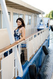 Girl travels by boat Royalty Free Stock Image