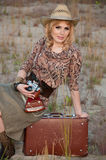 A girl travels in a cowboy hat Royalty Free Stock Photos