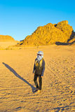 Girl travels the desert Stock Photography