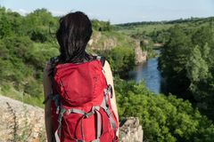 The girl travels.girl with a large backpack.tourist.red backpack royalty free stock images