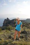 Girl travels through the mountains Stock Photo