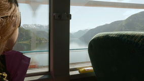 Girl travels to Norway by bus stock footage