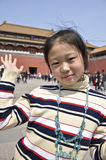 A girl travesl in china. A girl travels in china happily Royalty Free Stock Photography