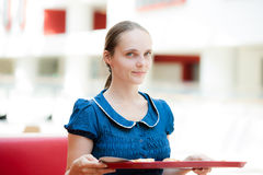 A girl with tray Royalty Free Stock Image
