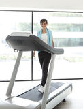 Girl treadmill Stock Photos