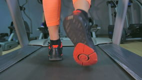 Girl on a treadmill stock video