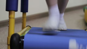 Girl on a treadmill. Little girl walks on a treadmill stock footage