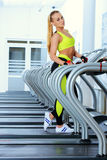 Girl on a treadmill Royalty Free Stock Photography