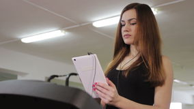 Girl on a treadmill stock video footage