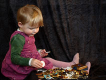 Girl with treasure. Little girl (2) playing with treasure Royalty Free Stock Photo