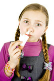 Girl treat a runny nose. Little Schoolgirl treat a runny nose Stock Photos