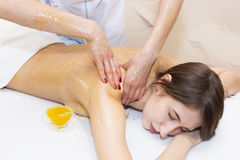 Girl treatment massage honey body wrap Royalty Free Stock Photo