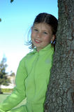 Girl and tree 1. Girl leaning on tree royalty free stock photo