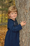 Girl Beside Tree Stock Photos