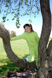 Girl and tree 2. Girl in tree royalty free stock image